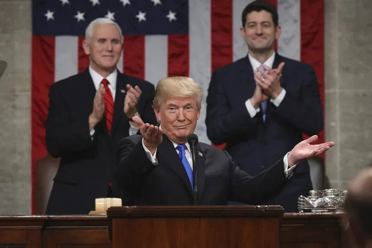 President Donald Trump gestures as he delivers his first State of the Union address in the House chamber of the U.S. Capitol to a joint session of Congress as Vice President Mike Pence and House Speaker Paul Ryan applaud.