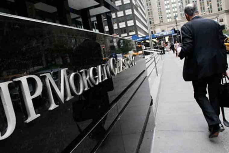 A man arrives at a JPMorgan Chase office building in New York Monday, May 14, 2012. JPMorgan, the largest bank in the United States, is seeking to minimize the damage caused by a $2 billion trading loss, disclosed Thursday by CEO Jamie Dimon. (AP Photo/Mark Lennihan)