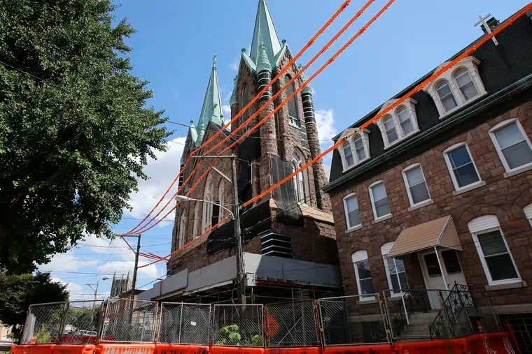 After the spires at Fishtown's St. Laurentius church were declared unsafe, a developer erected protective barrier on Berks Street. Last week, a demolition notice was posted on the door, and it may be a prelude to removing the towers.