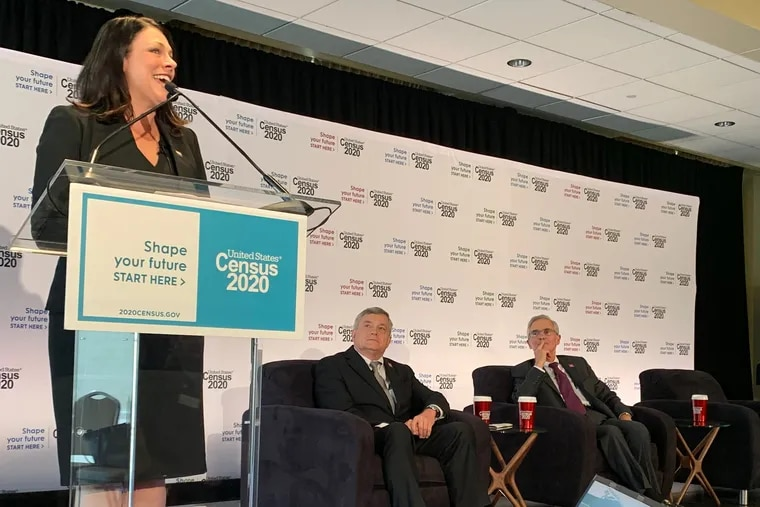 """Stephanie Reid, executive director of Philly Counts 2020, speaks at the Independence Visitor Center about her office's plan to train thousands of residents to be """"Census Champions"""" as Census Bureau Director Steven Dillingham and Fernando Armstrong, director of the Philadelphia Regional Office, look on."""