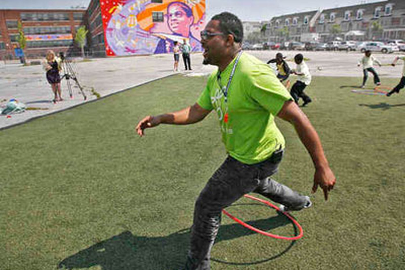 Recess coaches help kids play, and that helps them to learn