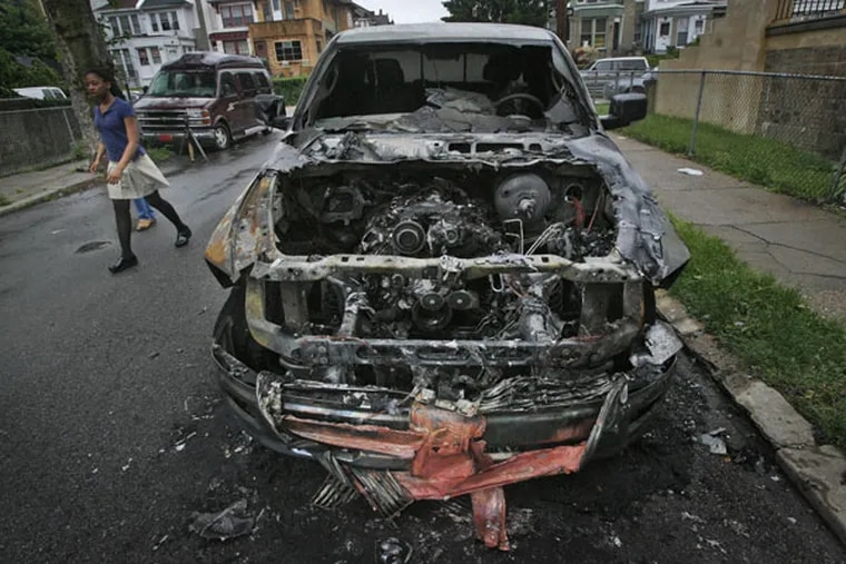 The hood of a Dodge Ram pickup became a gaping hole over a cindery mess of an engine after 7 cars were set on fire in the city's Wynnefield section on May 18, 2011.
