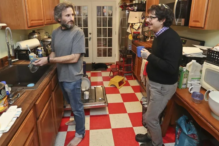 Matthew Solis, left, and Yoel Solis, right, share a moment in the kitchen while Matthew is preparing dinner for the family. Yoel transitioned from female to male.
