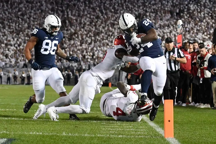 Penn State running back Keyvone Lee is tackled by Indiana linebacker Cam Jones (4) in the first half Saturday night.