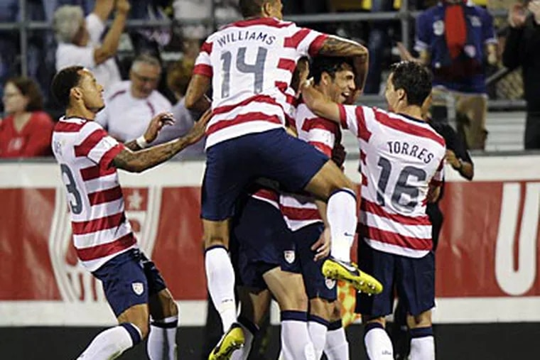 United States players celebrate a goal by Herculez Gomez against Jamaica during the second half. (Jay LaPrete/AP)
