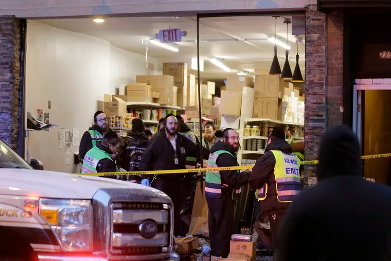 Emergency responders work at a kosher supermarket, the site of a shooting in Jersey City, N.J.