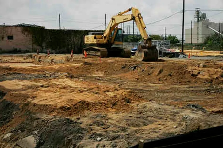 Workers remove contaminated soil at the Welsbach/General Gas Mantle Superfund site at Fourth and Jefferson Streets in Camden in 2018.