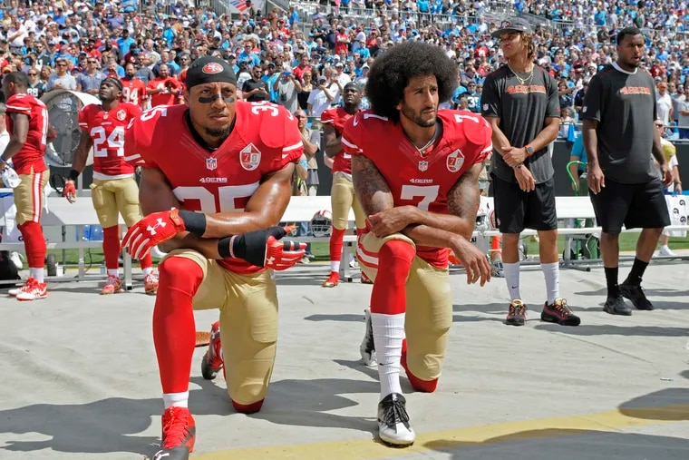 San Francisco 49ers' Colin Kaepernick (7) and Eric Reid kneeling during the national anthem before an NFL football game against the Carolina Panthers in Charlotte, N.C., on Sept. 18, 2016.