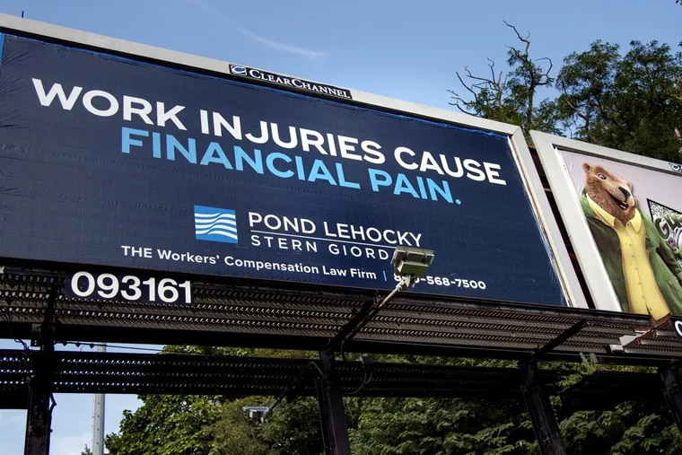 A billboard for Pond Lehocky Stern Giordano viewed from northbound South 26th Street, between Penrose Avenue and 1-76.