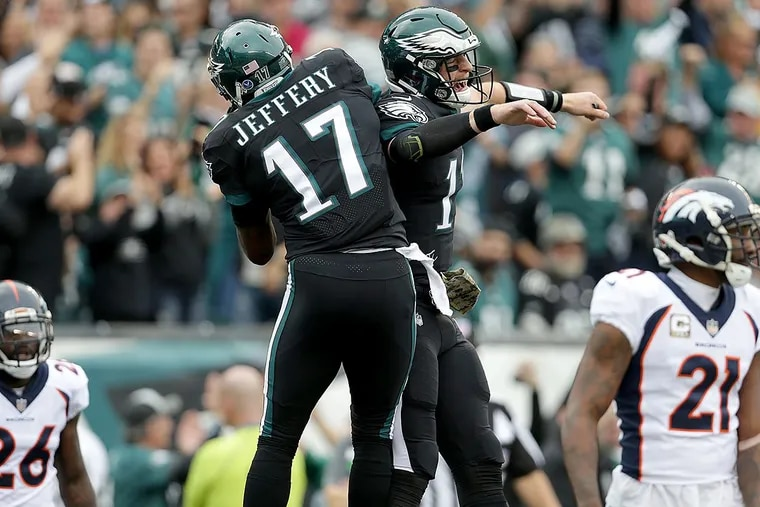 Eagles' Carson Wentz (right) celebrates with Alshon Jeffery after they connected on a touchdown against the Broncos.