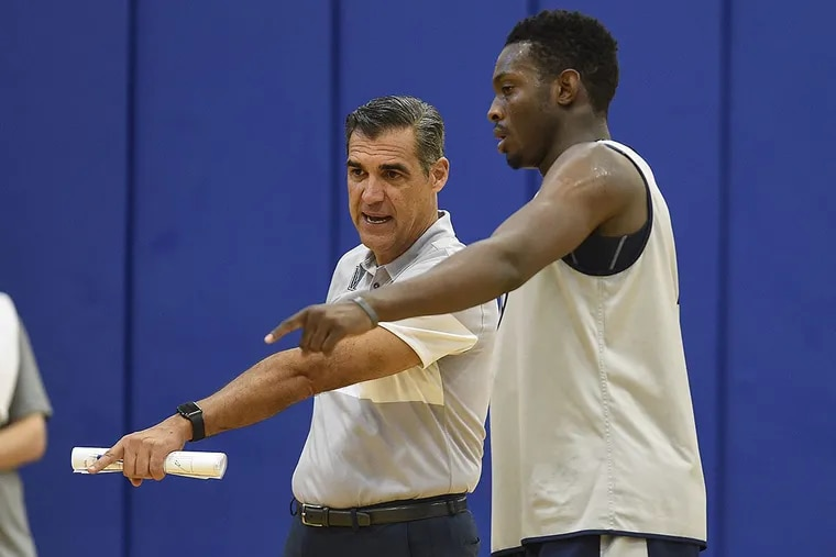 Villanova basketball coach Jay Wright discusses a play in practice with freshman Dhamir Crosby-Roundtree.
