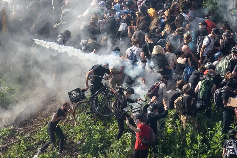 Tear gas is fired at protesters on I-676 in Philadelphia on June 1, 2020.