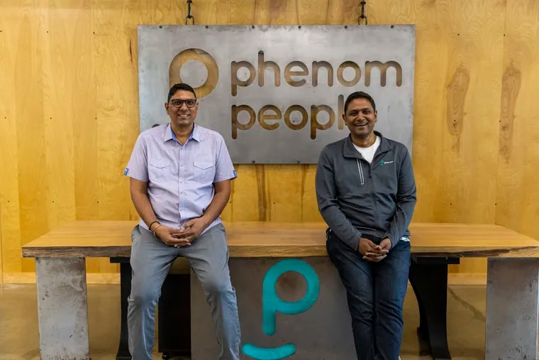Brothers and co-founders of Phenom People, Hari Bayireddi, COO, (left), and Mahe Bayireddi, CEO, (right), pose for a portrait at their office in Ambler, Pa., on July 7, 2021.