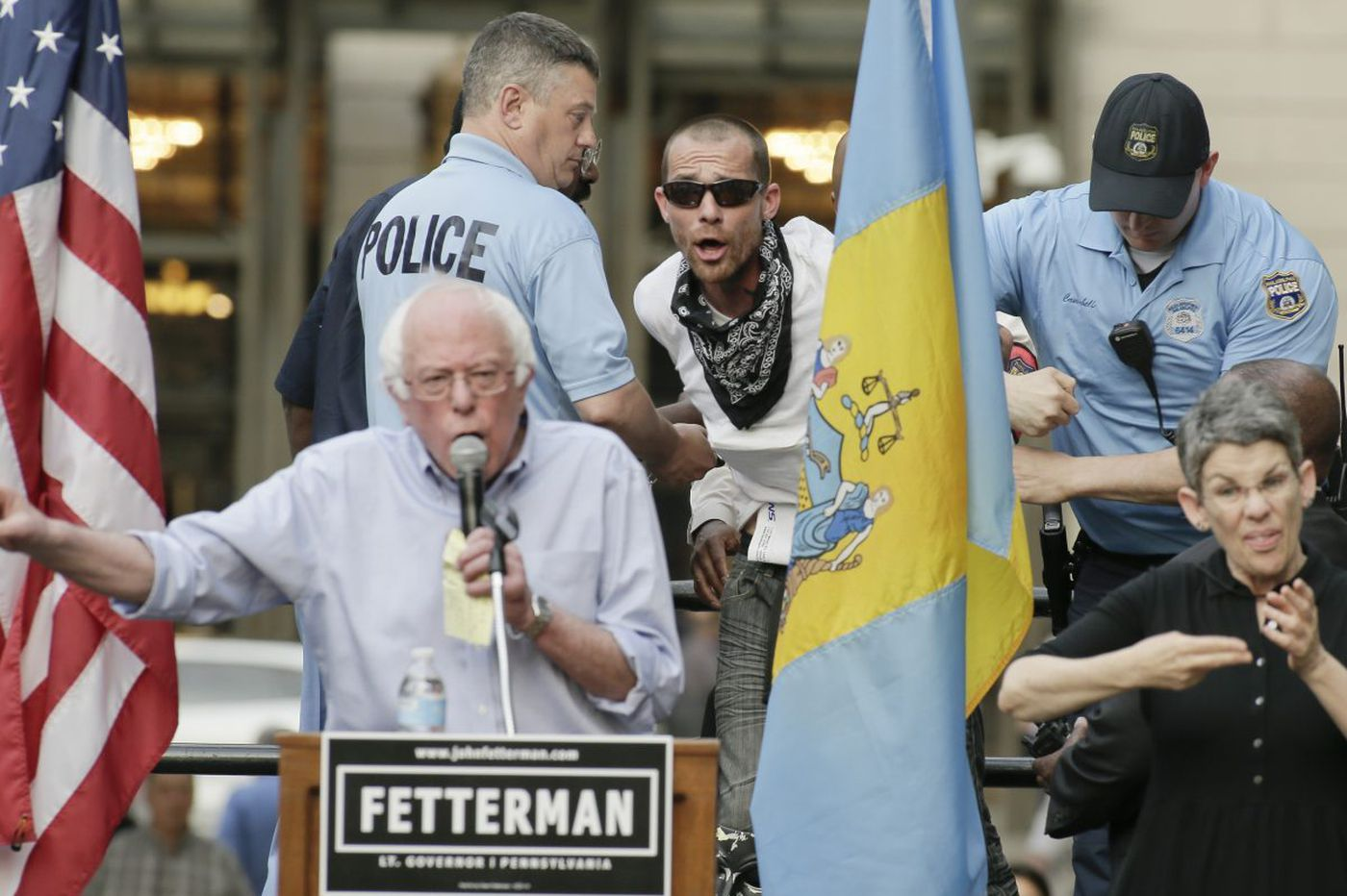 Protester detained by police at City Hall as Bernie Sanders stumps for Dems in Philly