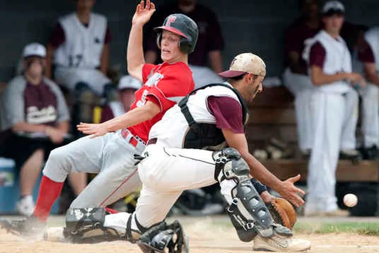 Parkland's Joe Abeln slides home to score past St. Joseph's Prep catcher Ray Toto in the first. Toto later homered.