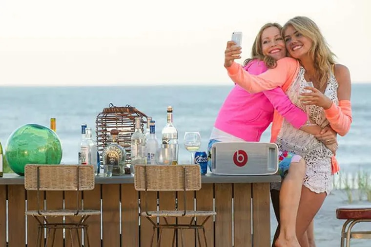 """Kate (Leslie Mann, left) and Amber (Kate Upton) frolic near the beach in """"The Other Woman""""  (Barry Wetcher/Twentieth Century Fox)"""
