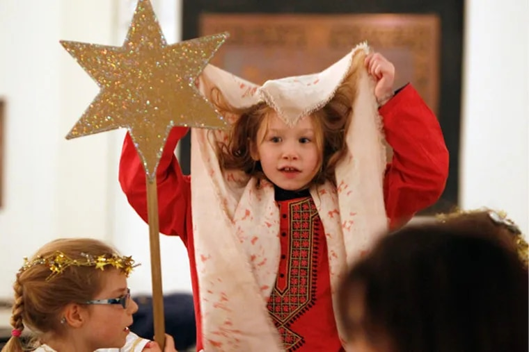 Before the Christmas pageant at St. Peter's Episcopal Church, Adar Nelson (center), playing Mary, and Audrey Abbott, as an angel, get ready. (Ron Cortes / Staff Photographer)