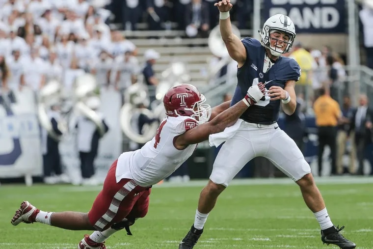Temple's Jullian Taylor putting pressure on as Penn State QB Trace McSorley throws an incompletion last September.