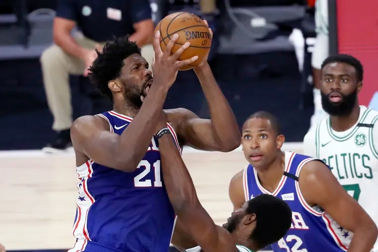 Philadelphia 76ers center Joel Embiid (21), who had 30 points and 10 rebounds, is fouled by Boston Celtics forward Semi Ojeleye, bottom, during the second quarter of Game 4 of an NBA basketball first-round playoff series, Sunday, Aug. 23, 2020, in Lake Buena Vista, Fla.