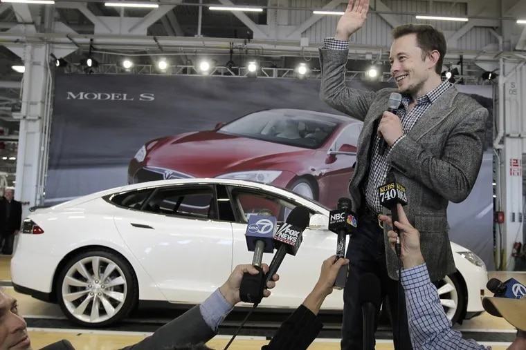 Tesla CEO Elon Musk shows off the latest moderl during a rally at the factory in 2012.