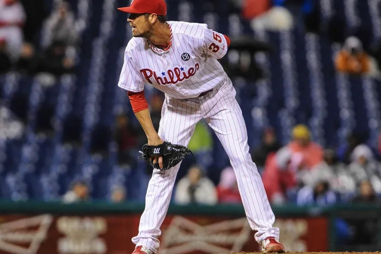 Cole Hamels struggled on a cold and rainy night, losing to the Mets.