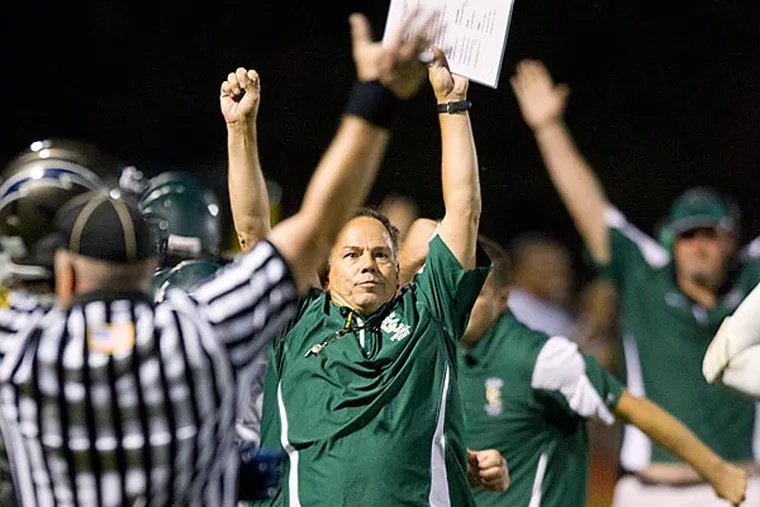 Camden Catholic's head coach Gil Brooks thrusts his hands in the air after an interception. This play essentially sealed the win for Camden Catholic. (Ed Hille/Staff Photographer)
