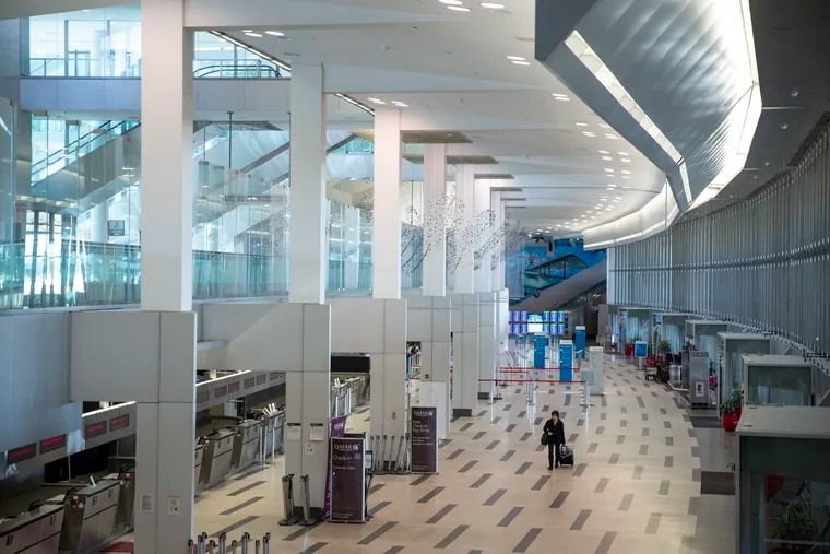 A mostly empty international check-in area at the Philadelphia International Airport on March 16.