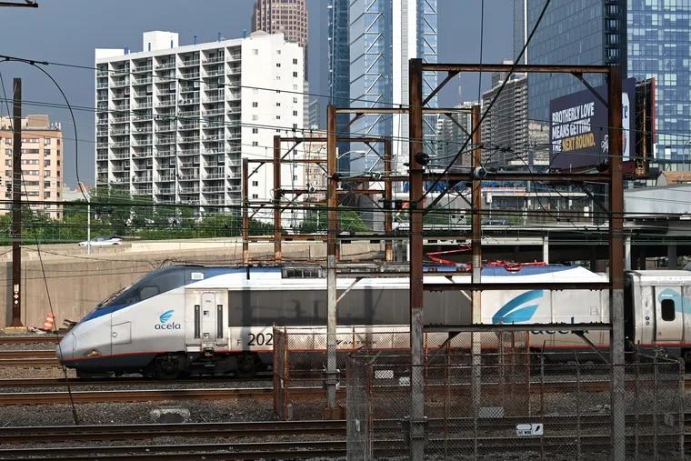 A northbound Amtrak Acela passenger train departs 30th Street Station in Philadelphia.
