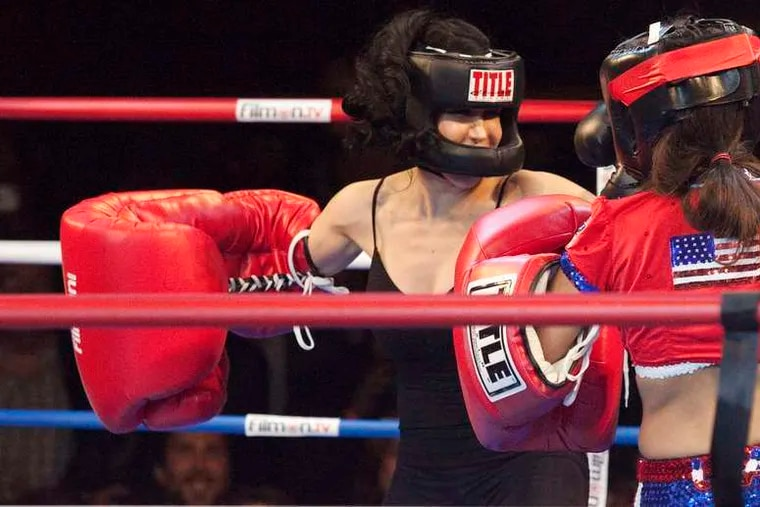 """Nadya """"Octomom"""" Suleman (left) mixes it up with Amy """"Point Blank"""" Fisher during Saturday's """"Celebrity Fight Night."""""""