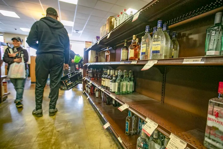 At the Fine Wine and Good Spirit Store in the Ivyridge Shopping Center in Roxborough, customers were greeted with some empty shelves before stores closed due to the coronavirus.