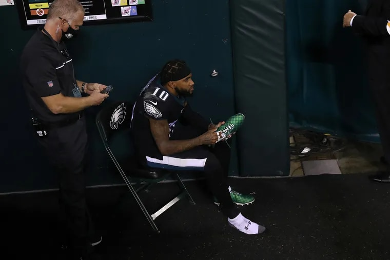 Eagles wide receiver DeSean Jackson watches from the tunnel after he was injured on a fourth-quarter punt return.