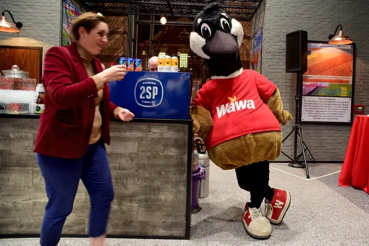 Wawa mascot Wally Goose hanging out listening to tunes at Wawa's flagship store at 6th and Chestnut Streets.