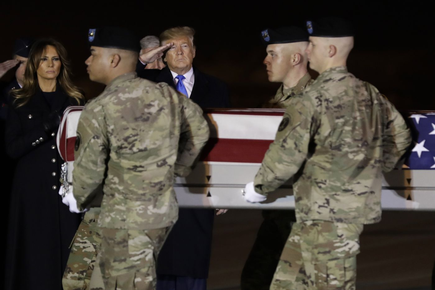 Trump makes unscheduled visit to Dover to receive remains of two fallen soldiers