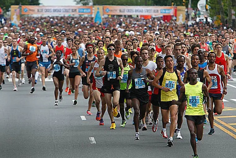 The 40,000 runners ready to compete in Sunday's 34th annual Broad Street Run found a different way to reach the starting line this year. (Akira Suwa/Staff file photo)