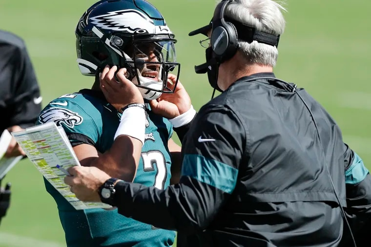 Eagles coach Doug Pederson (right) is turning to rookie quarterback Jalen Hurts Sunday. Is he throwing him to the wolves?
