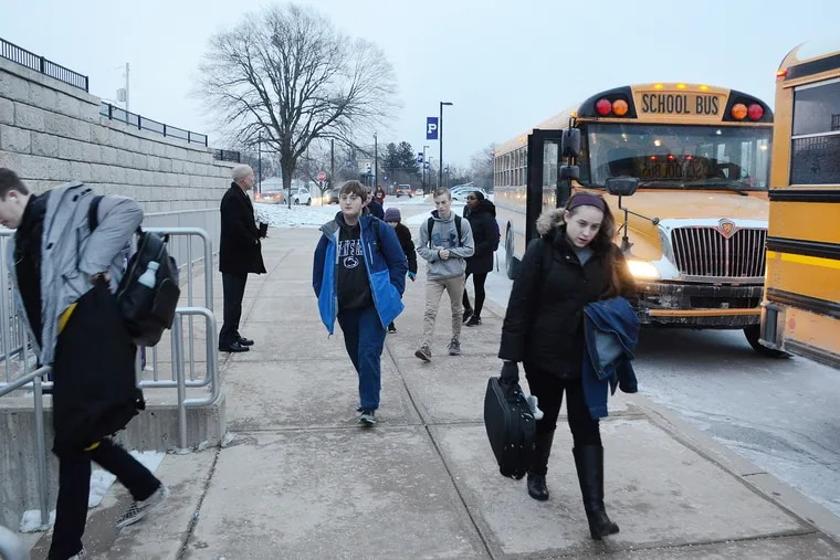 Students arrive for classes at Phoenixville Area High School on Friday at 7:10 a.m. Next year, they'll get to sleep in when the district pushes school start time back to to 8:05.