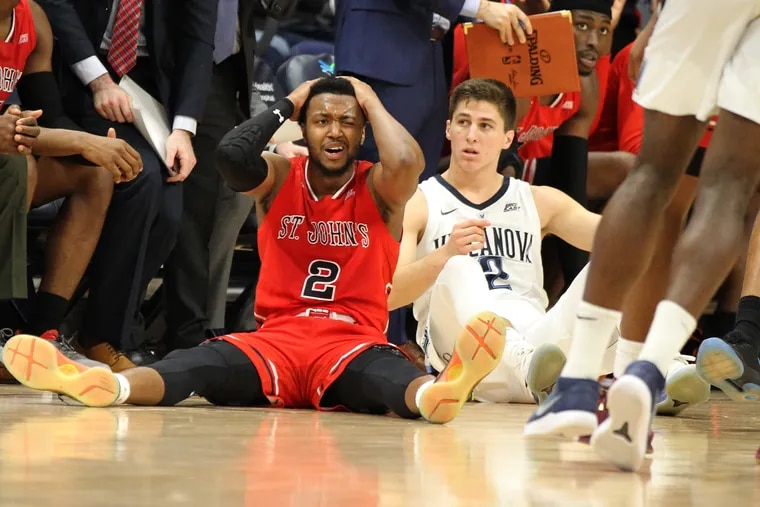 Collin Gillespie (right) wtaches as St. John's Shamorie Ponds gets called for a foul late in Tuesday's game.