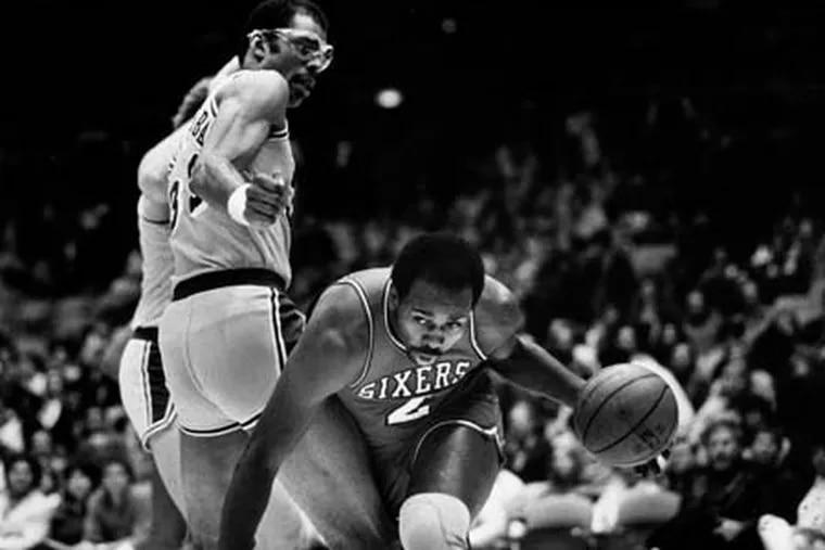 Moses Malone of the 76ers drives past Kareem Abdul-Jabbar during Game 4 of the 1983 NBA Championships, when the 76ers swept the Lakers.