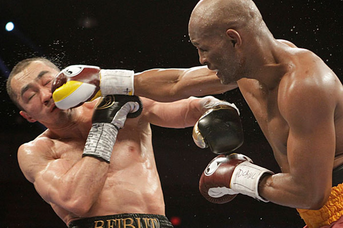Hopkins beats Shumenov to unify titles