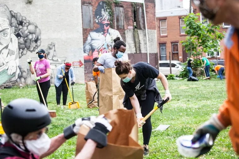 Community volunteers and staff from New Kensington Community Development Corporation clean up along Kensington Avenue in June 2020. Wells Fargo Regional Foundation supports a wide variety of NKCDC's work in Kensington.