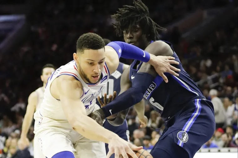 Sixers guard Ben Simmons dribbles past Mavericks forward Johnathan Motley during the third quarter of the Sixers' win on Sunday.