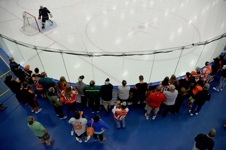 Flyers' fans, shown watching a scrimmage at training camp in 2015, will be allowed at training camp, which begins on Sept. 23. Fans have not been permitted at Voorhees for 18 months due to COVID-19 restrictions.