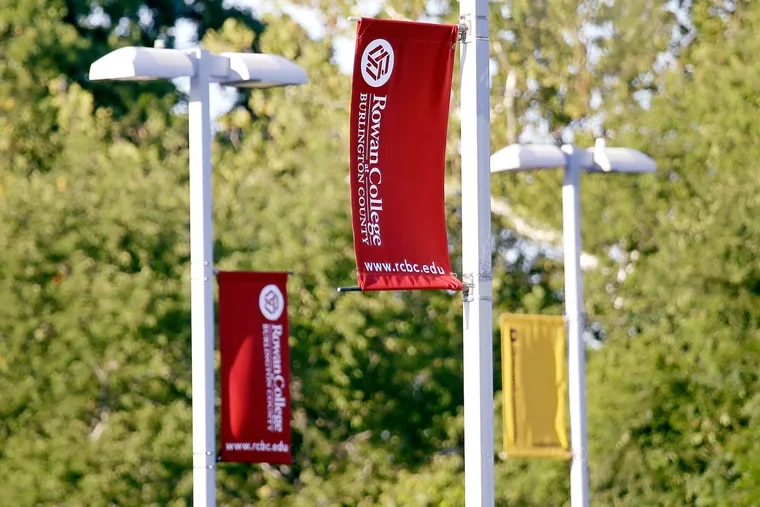 At Rowan College at Burlington County, red banners promoting RCBC are joined by gold banners promoting Rowan University.