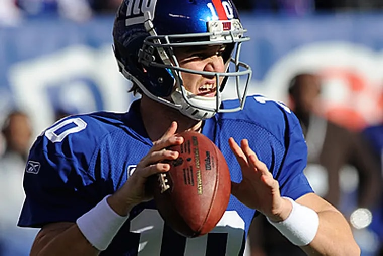 Eli Manning leads the league with 19 interceptions. He threw three against the Eagles in their last meeting. (AP Photo/Henny Ray Abrams)