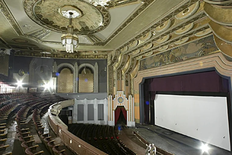 A real estate developer and  Clear Channel Communications Inc. said they would renovate the historic, former Boyd Theater in Philadelphia for concerts and shows. (AP)