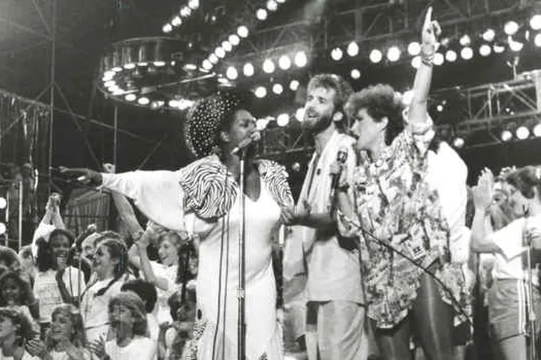 """Live Aid (left) in 1985 featured Madonna, Eric Clapton and the Cars.The Who (below) was on the first of its """"farewell"""" tours in 1982."""