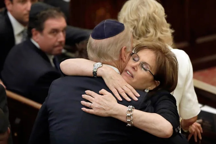 Bonnie Englebardt Lautenberg, widow of U.S. Sen. Frank Lautenberg, embraces Vice President Joe Biden, before her husband's funeral, in New York's Park Avenue Synagogue, Wednesday, June 5, 2013. Lautenberg, a liberal Democrat from New Jersey, died Monday after suffering complications from viral pneumonia. At 89, he was the oldest member of the Senate and the last of 115 World War II veterans to serve there. (AP Photo/Richard Drew, Pool)