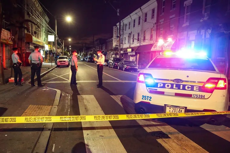 Philadelphia police investigate in the 25th District a triple shooting homicide on Wednesday, May 27, 2020.