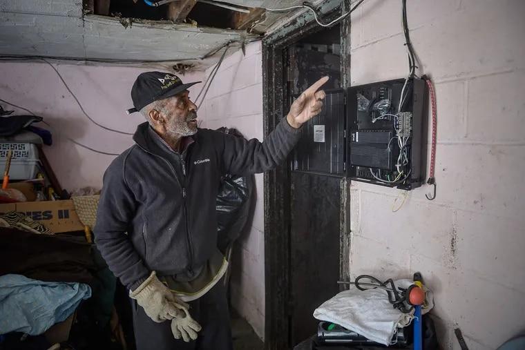 James LaRoy, 83, says Verizon installed this fiber box in his garage, damaging the garage door.