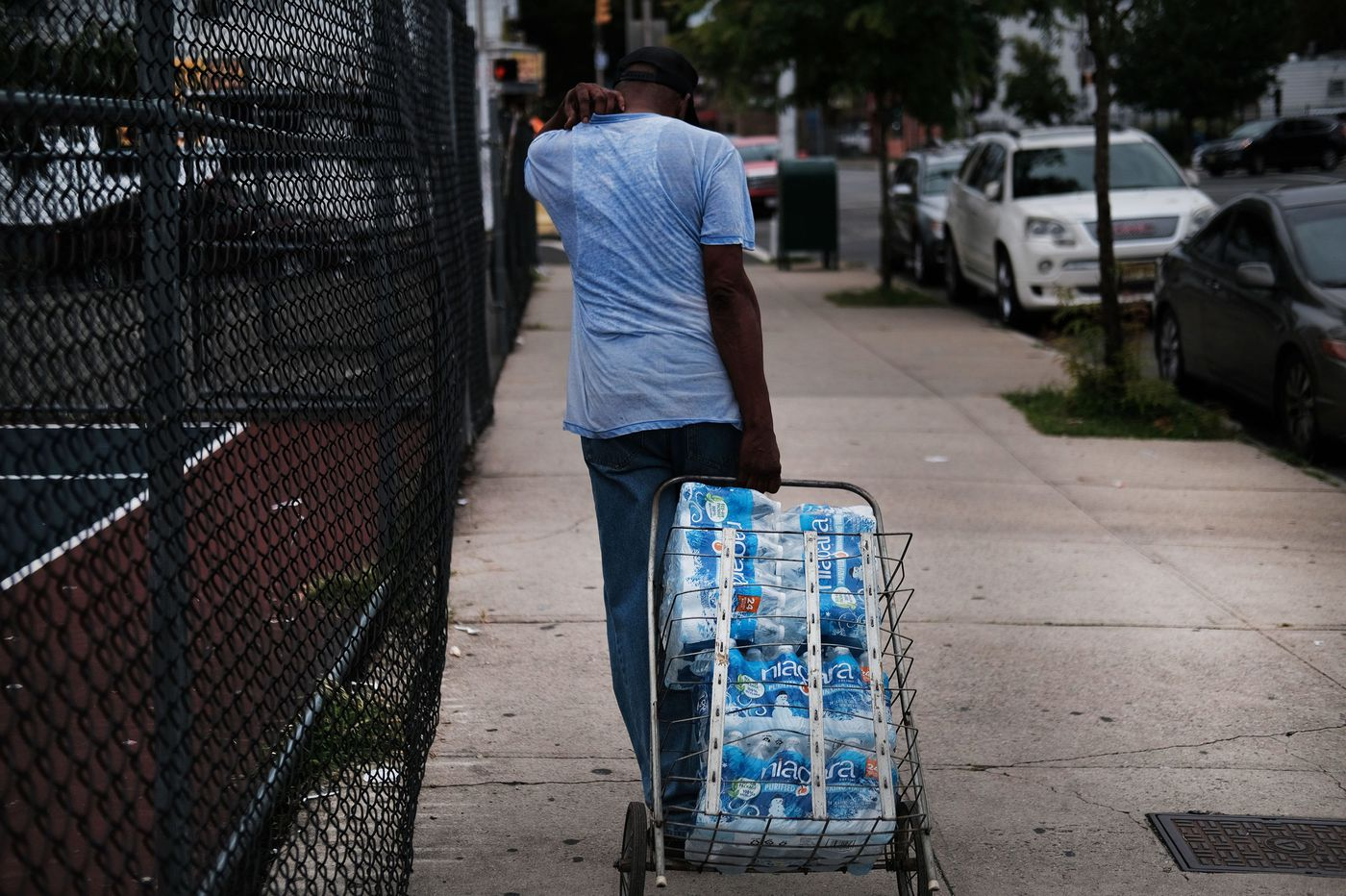 Water distribution continues as lead problem assessed
